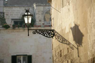 odd street lamp shadow in sunny florence