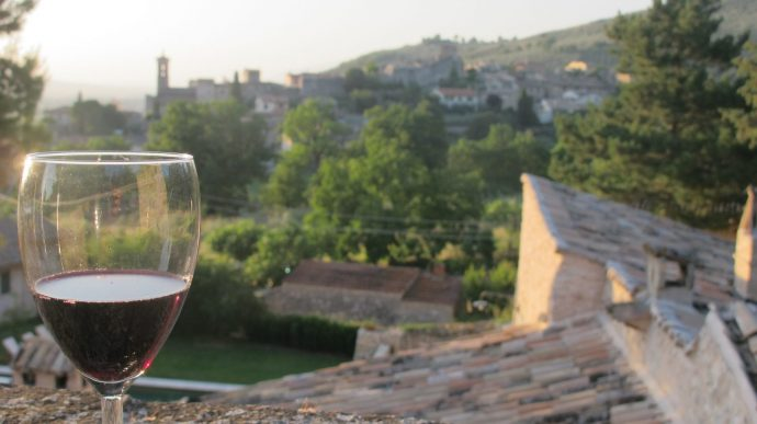 Glass of red wine overlooking Italian sunset view