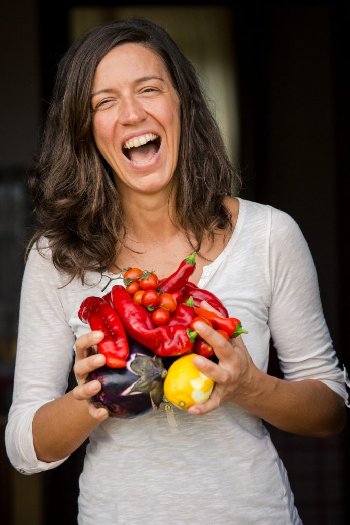 Italian chef laughing with fresh produce
