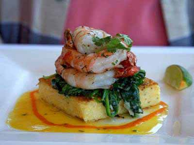 Polenta square with shrimps on top