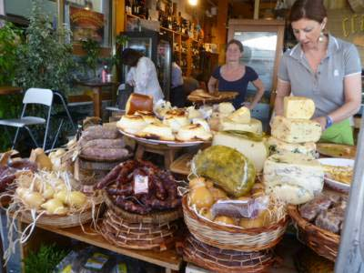 Sicilian food market with cheeses