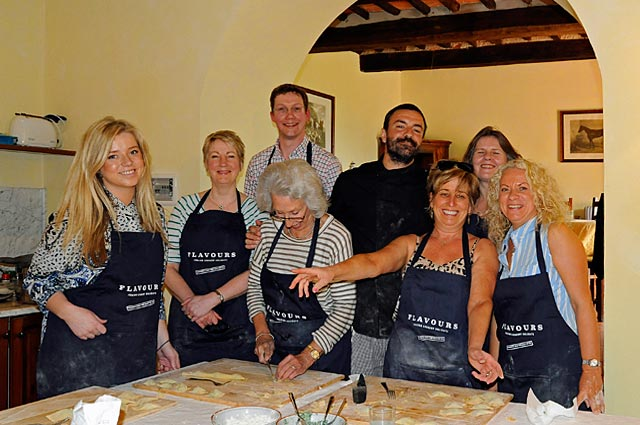 Kathryn Burrington cooking with our guests in Tuscany
