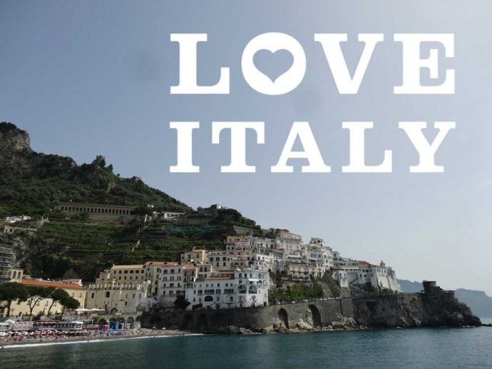 Breathtaking view of the Amalfi coast and a love Italy banner