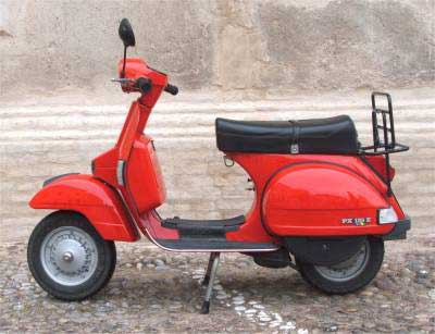 red Italian Vespa parked in the street