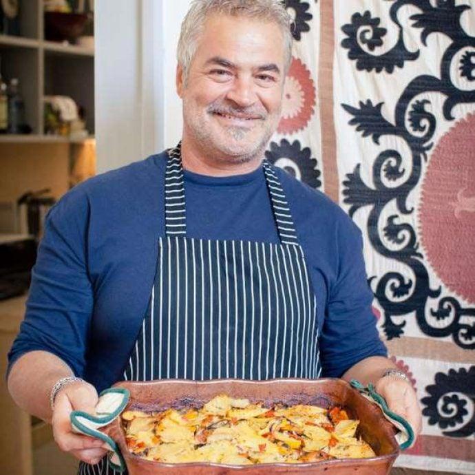 Flavours chef Antonio holding freshly prepared food.