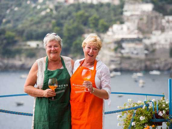 Two single travellers laughing in Amalfi