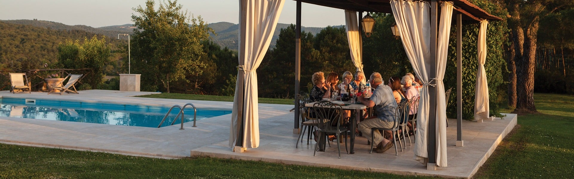 Our language teacher with guests enjoying Italian food in evening sunshine.