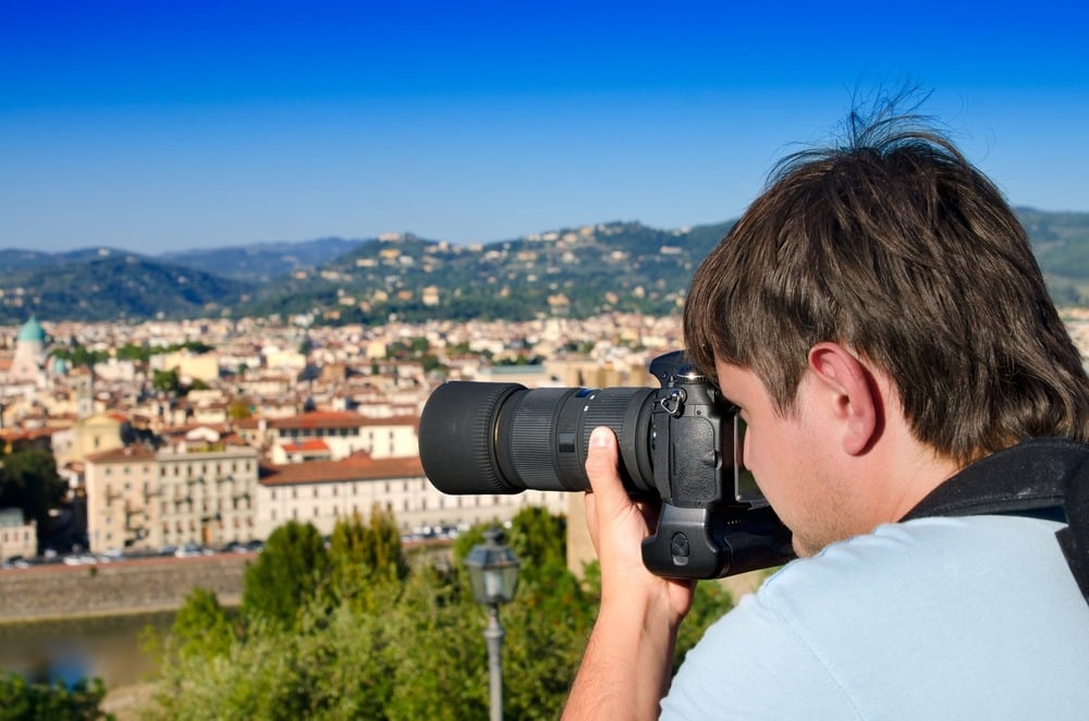 Photographer taking a picture of the scenery in Italy