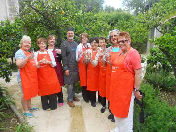 Group of guests with Italian chef in Puglia