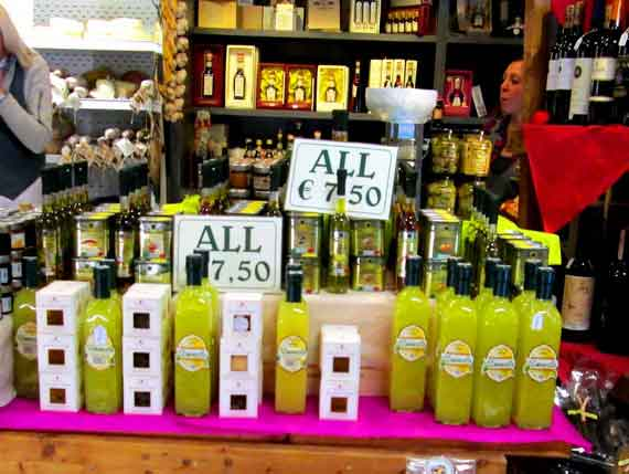 Limoncello bottles on food market in Amalfi