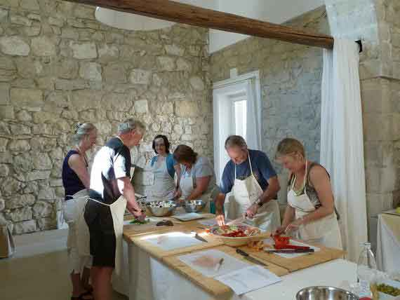 Cookery guests with chopping boards and knives.