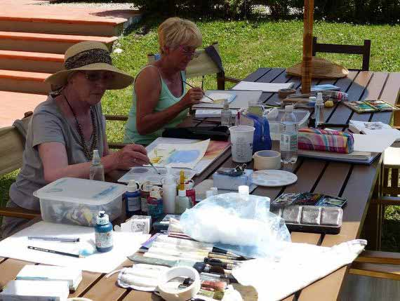 Women painting outside in the garden