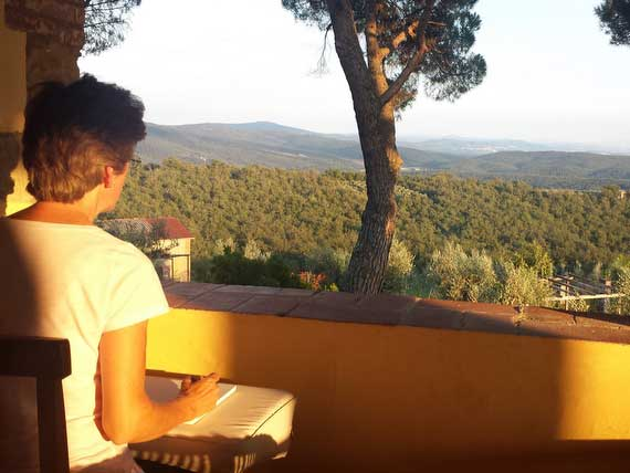 Guest starting a painting of a Tuscan hill.