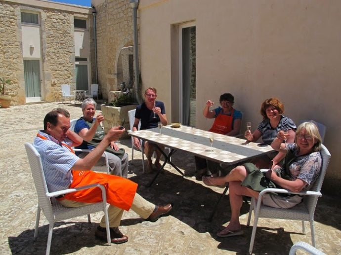 cooking guests in Sicily enjoying a glass of Prosecco