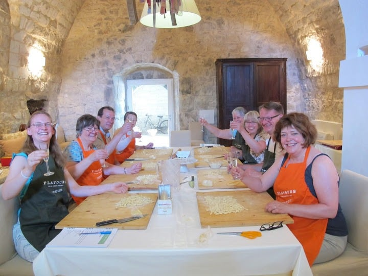 Happy guests during cooking lessons in Sicily.