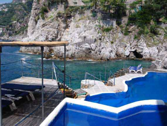 Outdoor pool at our Amalfi holiday villa surrounded by glittery sea.