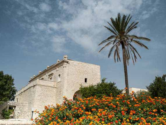 The stylish exterior of our venue in Sicily, with stone walls.
