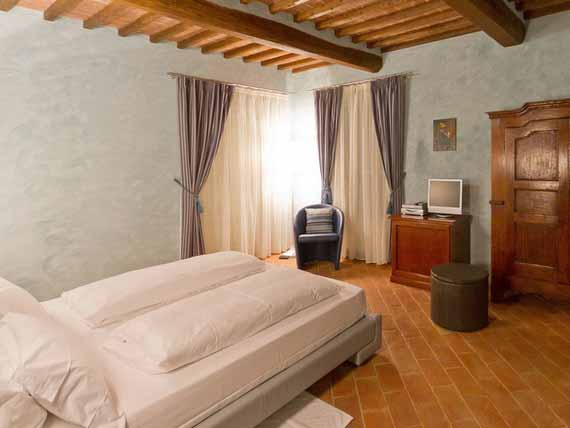 Comfortable bedroom in Tuscan villa
