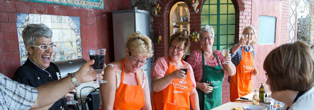 Cooking lessons on Italian holiday with delicious wine and laughter