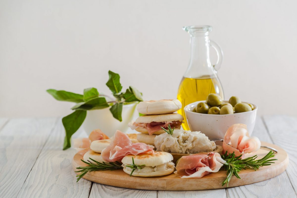 Round breads from Emilia Romagna with prosciutto, olives and herbs