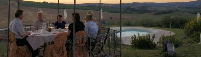 group of painting students enjoying the Tuscan sun set