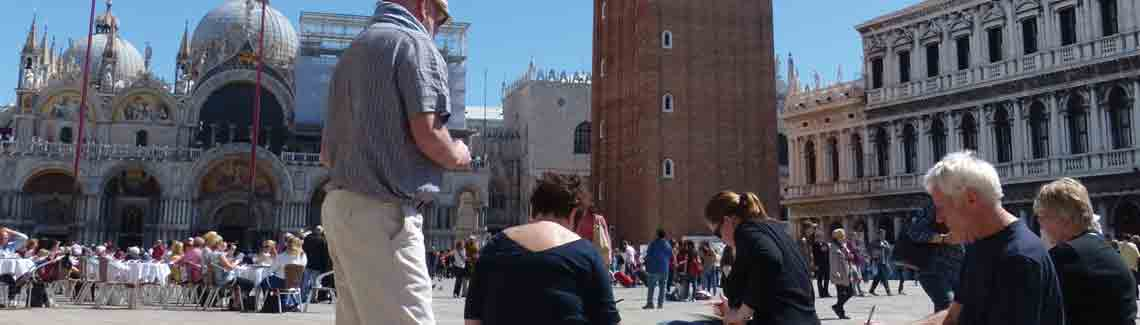 Students painting in watercolours on St. Mark's square in Venice