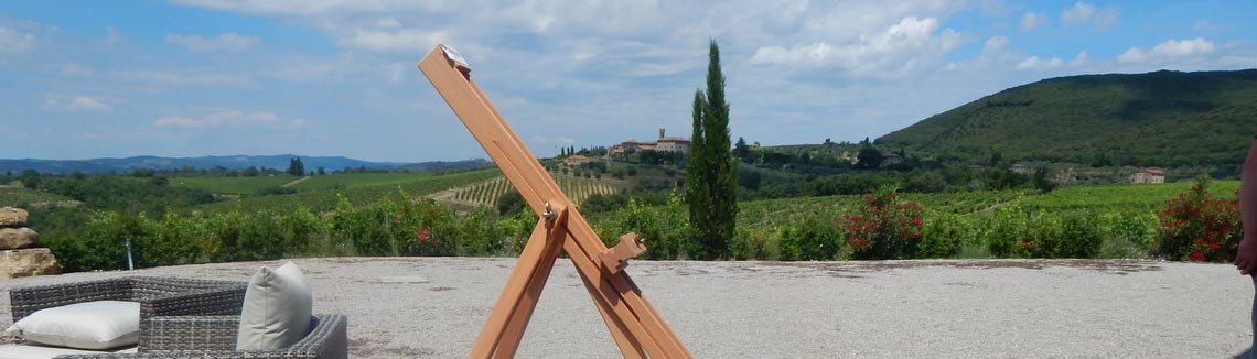 Easel with beautiful Tuscan landscape in the background