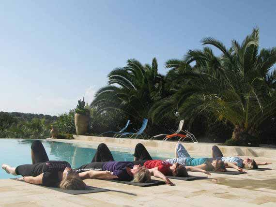 Pilates students relaxing by pool