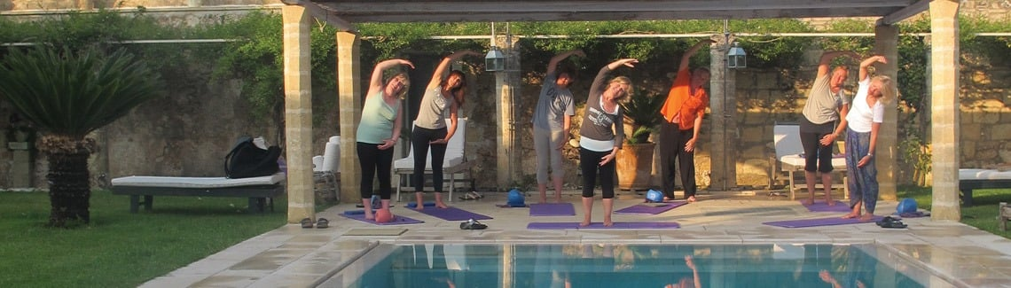 Pilates class in Puglia outside by the pool under the Italian sun