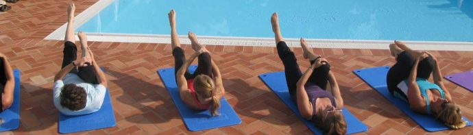 Pilates lessons by the pool at the holiday villa in Tuscany