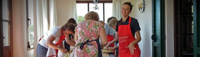 Italian host livia teaching cookery guests during lessons in Tuscany