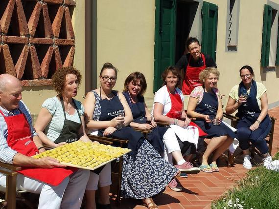 Cooking group outside enjoying Tuscan sunshine and Prosecco.
