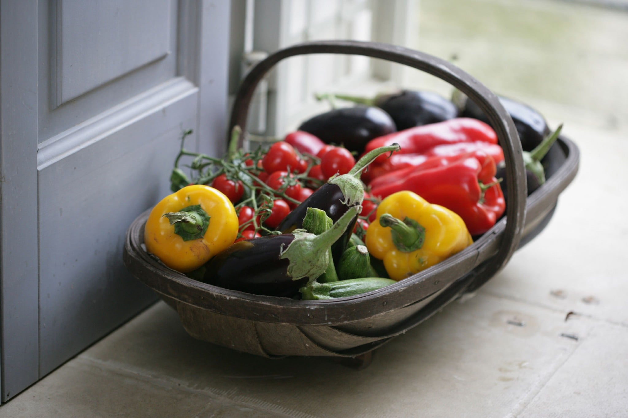 A delicious looking basket full of fresh Italian vegetables