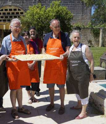 Guests outside in Puglia presenting their homemade Italian pasta