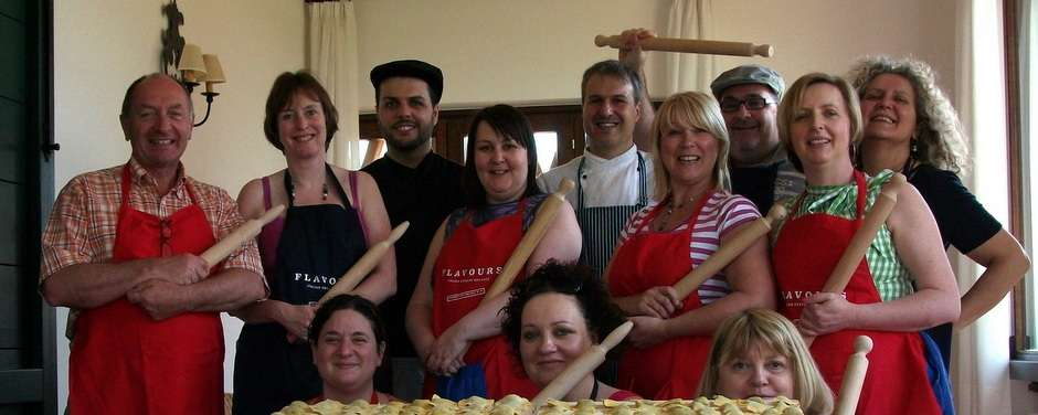 Italian Chefs Claudio & Marco with cooking guests.