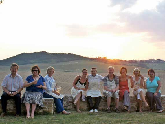 Pilates group enjoying a sunny evening outside with Italian chefs