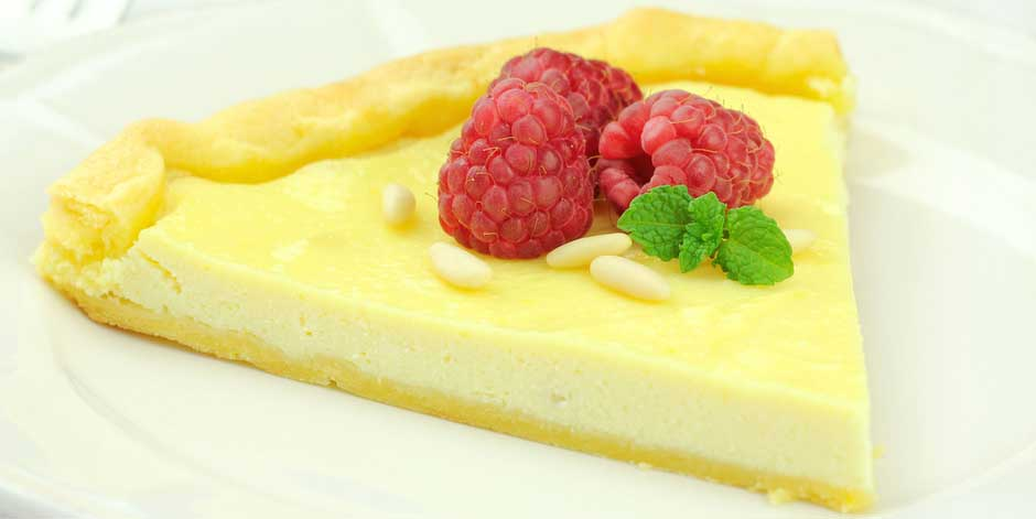 Delicious Ricotta Tart served with pine nuts and rasberries