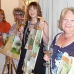 Painting guests exhibiting their art work from Italian holiday