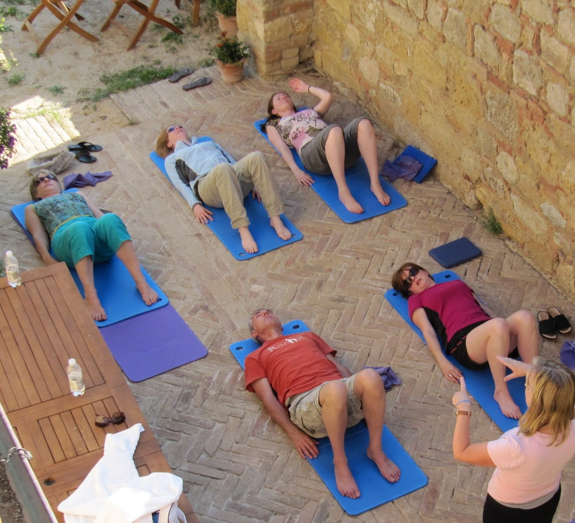 Group of Pilates students with instructor in relaxation position