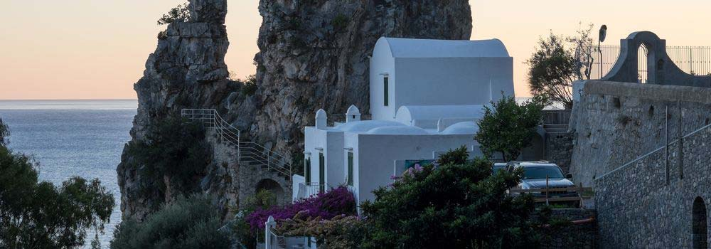 Scenic view of white house with the Amalfi coast in background