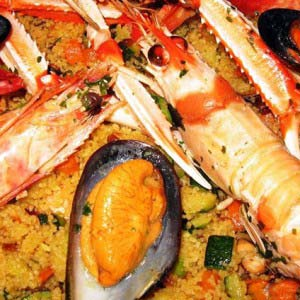 Delicious plate of couscous served with fresh seafood