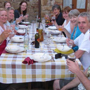 Group of Single Traveller eating and drinking at table outside