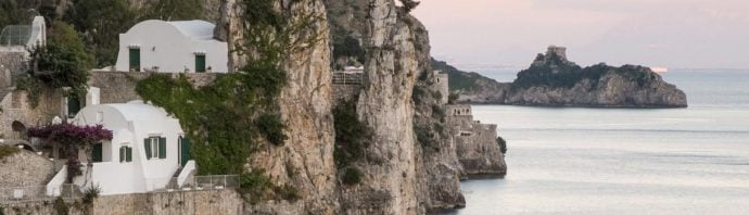 View of the picturesque coastline and cliffs in Amalfi at sunset