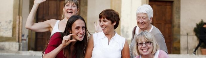 italian language students laughing with- teacher