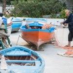 local fisherman with his boats at the Amalfi coast