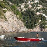 Italian young man on boat on the Amalfi Coast