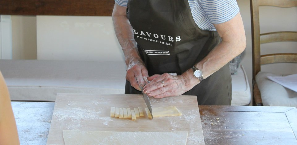 cutting-pasta-dough-into-shape