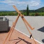 painting in Tuscany with an easel of a landscape