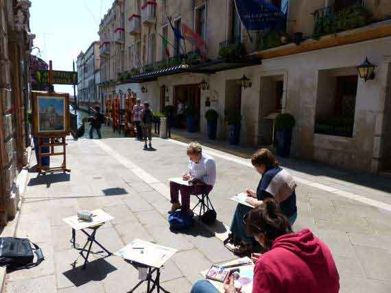 painting students outside in Venice streets with brush and easel