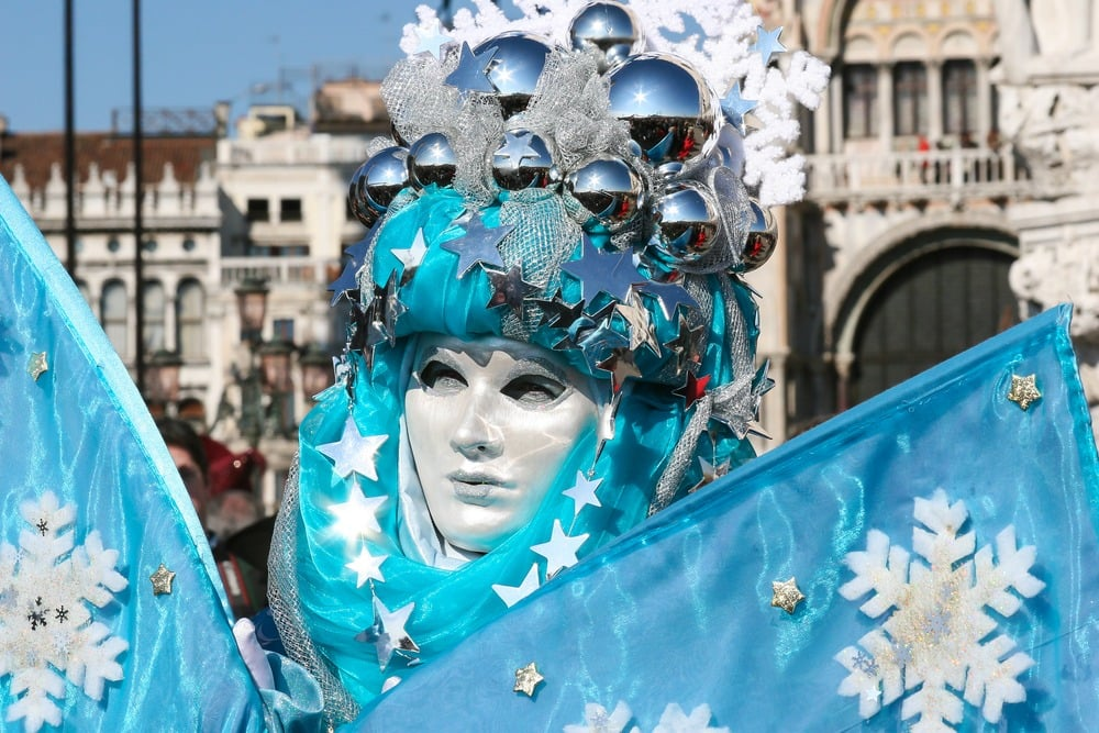 Person dressed up in costume and mask for Venice Carnival